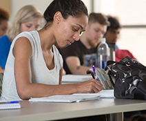 Female students taking notes in class