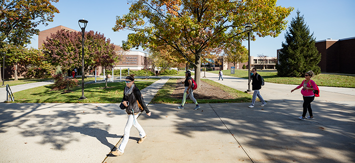 Students walking on campus during a sunny day