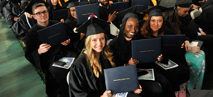 ccbc graduates proudly showing their degrees