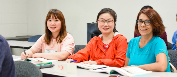 Photo of 3 female students sitting in class