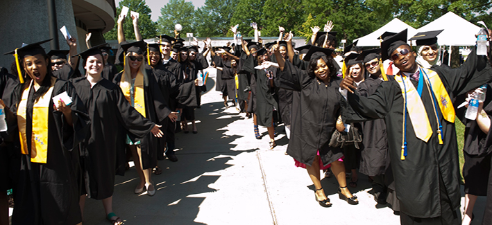 Group of students on commencement day excited to graduate