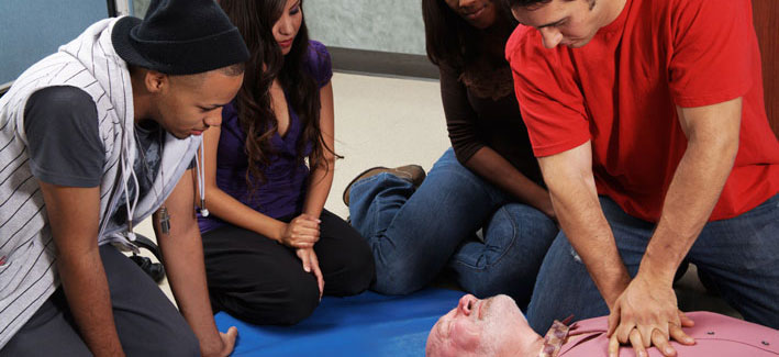 Students performing CPR on a manikin