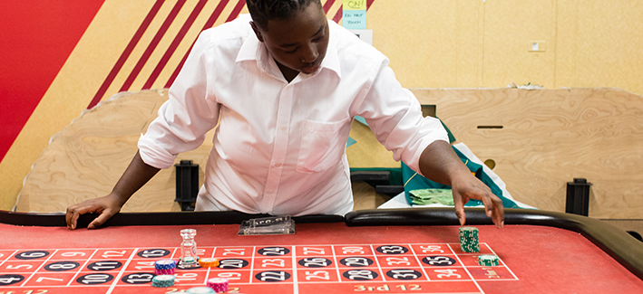 casino dealer dealing chips on table