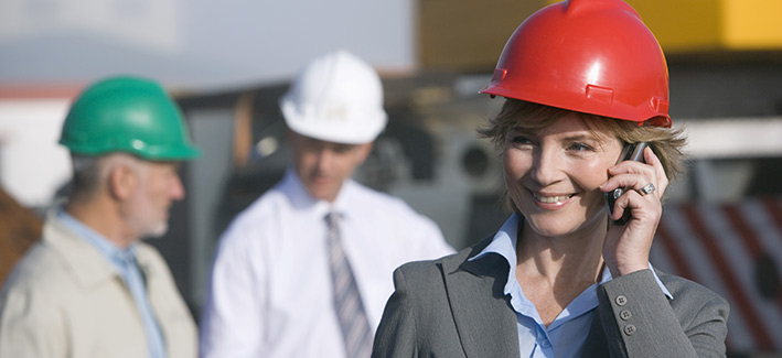 Business woman on the phone at a construction site