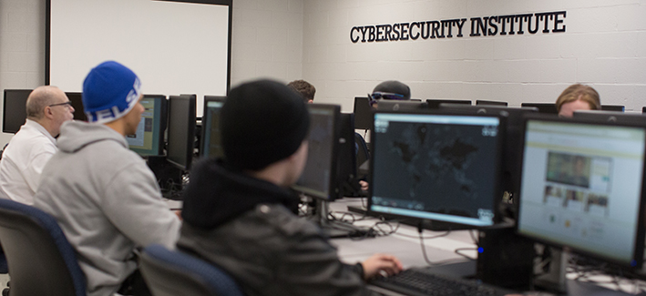 Students sitting in class at the cybersecurity institute