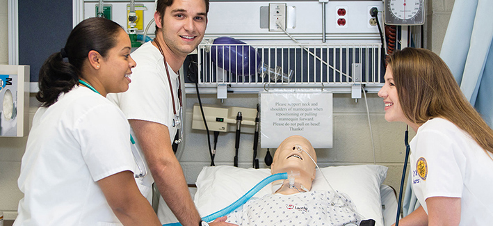 nursing students in a working lab