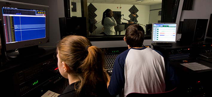 Students working in a music recording studio