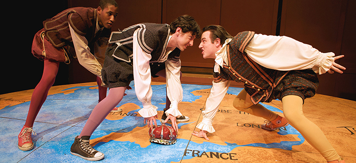 3 Shakespearean actors pay football on a globe