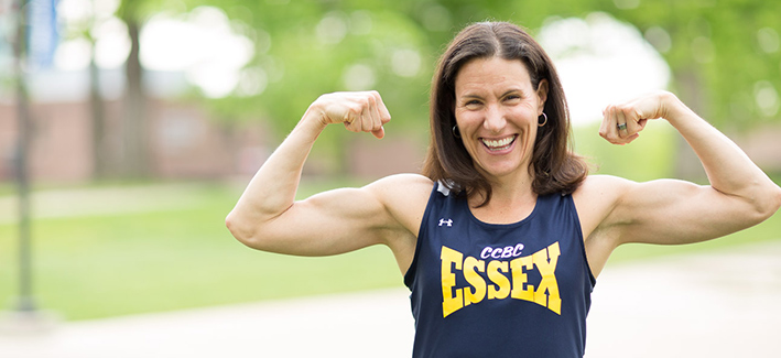 woman wearing an essex tank top