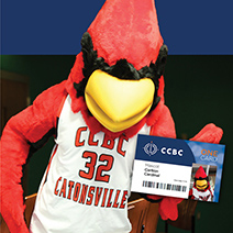 CCBC Cardinal Mascot holding the CCBC OneCard