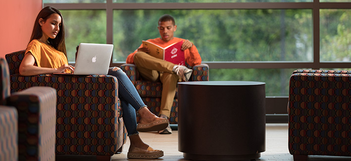 photo of students working in a common area on campus
