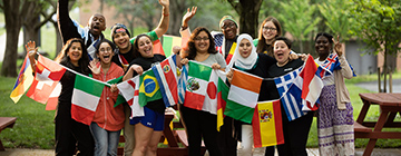 bunch of international students holding flags from around the world