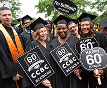 2017 graduates holding signs to celebrate CCBC's 60th anniversary