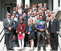 A photo of CCBC students standing on the stairs of a government building