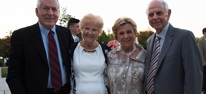 Four donors smile for a photo at the Romadka dedication ceremony