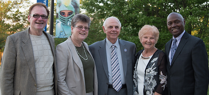 A group of donors smile for a photo at the Romadka dedication ceremony