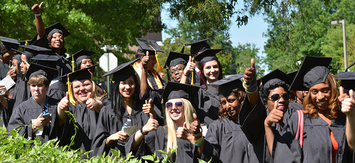 CCBC students posing for a photo on commencement day wearing cap and gowns