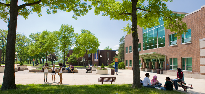 Outdoor photo of the CCBC Essex campus on a sunny day with students walking around