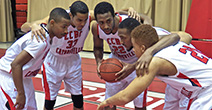The CCBC men's basketball team huddles together to stratize for the game