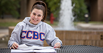 ccbc student sitting outside studying