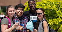 photo of students outside enjoying cotton candy at a welcome event