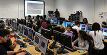 Students working in an information technology class